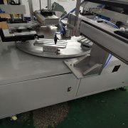 two color conveyor screen printer of part